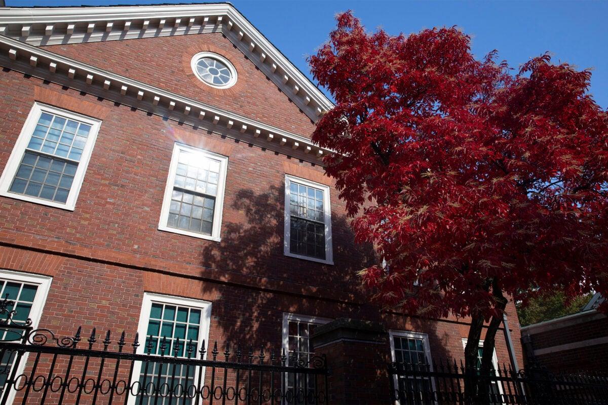 Crimson foliage frames Wigglesworth House in Harvard Yard.