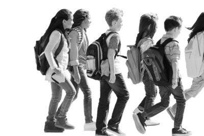 Photo illustration of traumatized child watching peers.