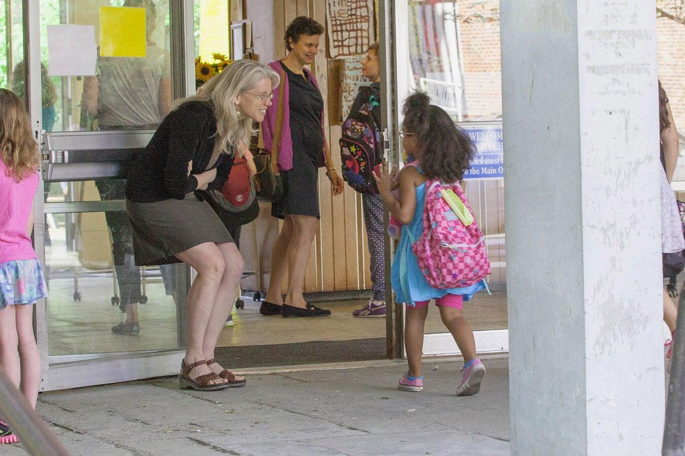 Sarah Fiarman greeting a child.