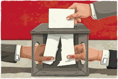 People with hands in ballot box.