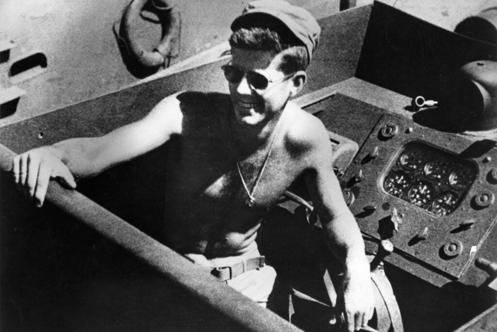 John F. Kennedy posed in boat PT 109.