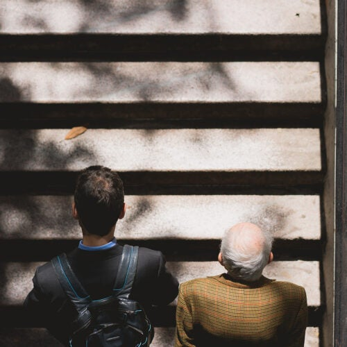 Two people going up stairs.