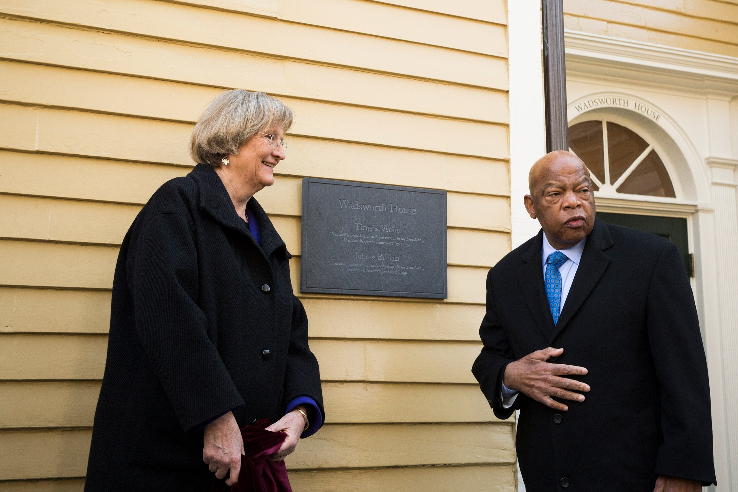 Harvard President Drew Faust and Congressman John Lewis unveil a plaque that recognizes four slaves who worked at Wadsworth House.