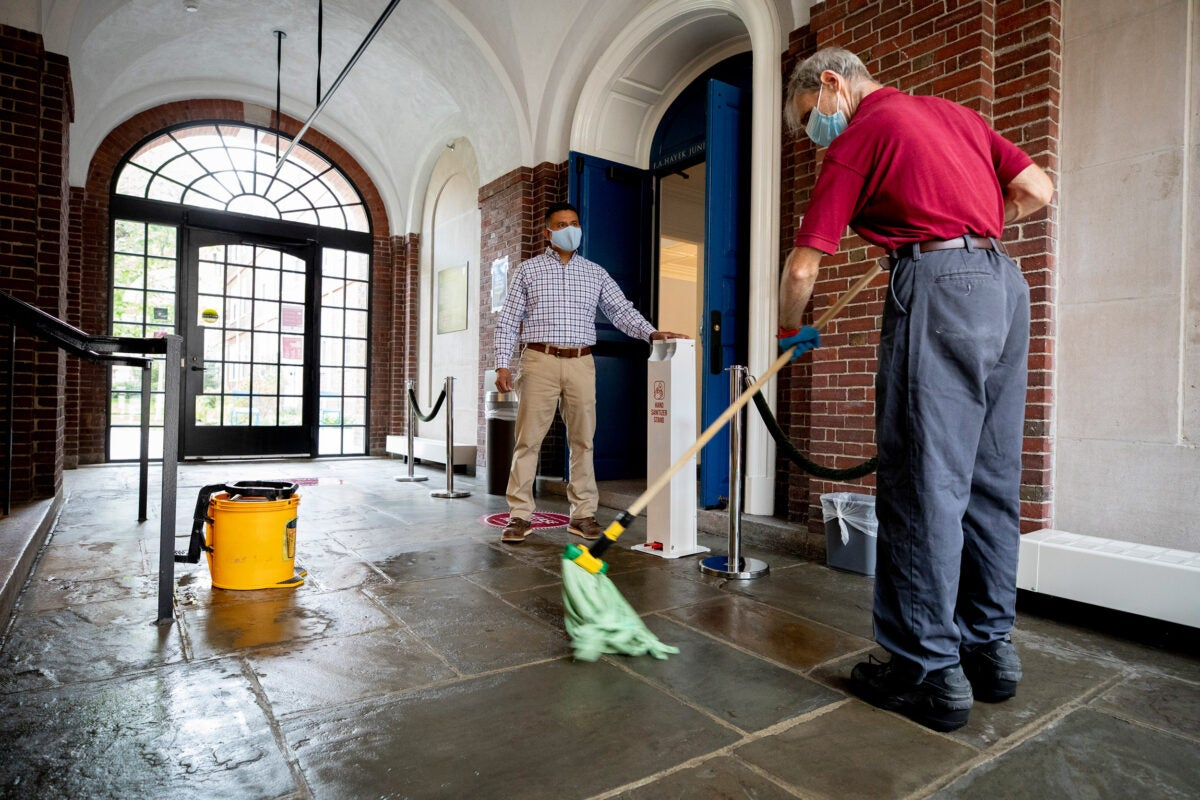Elson Callejas overseeing cleaning at Lowell House.