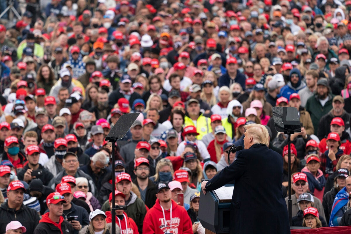 President Trump talking to a mask-free crowd.
