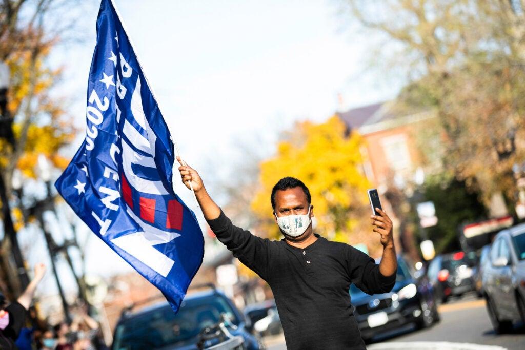 Man holds Biden flag.