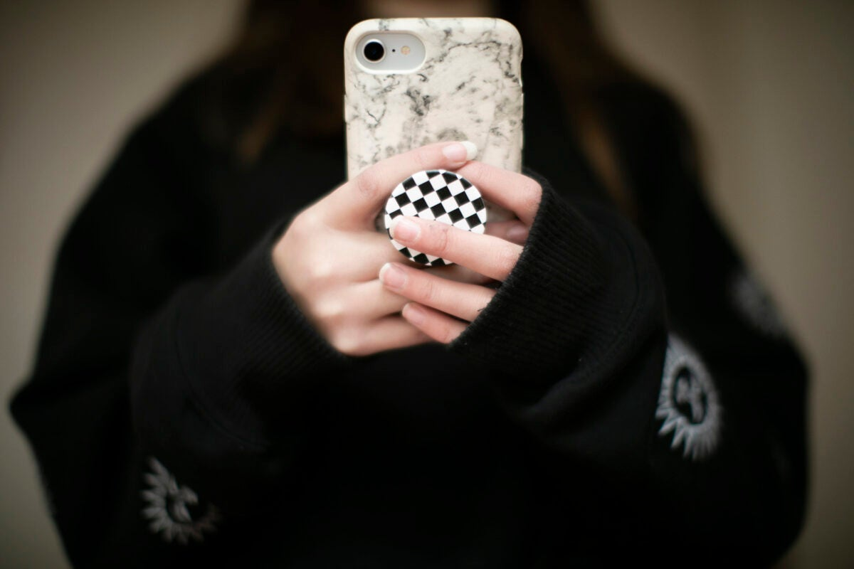 Person holding phone.