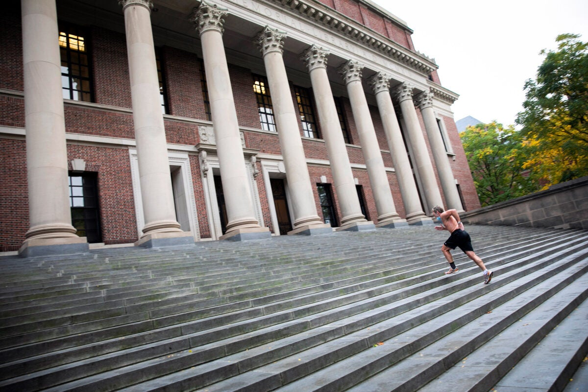 Man running steps at Widener Library.