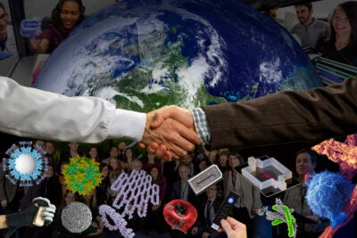 Photo illustration of men shaking hands in front of the Earth.