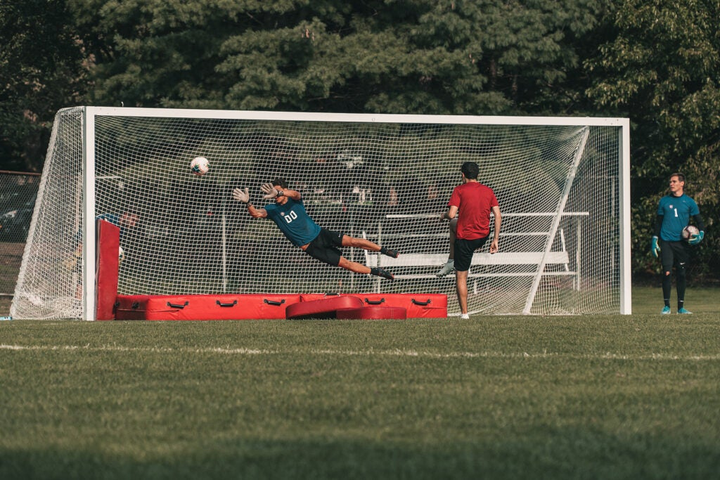 Philip Geanakoplos playing soccer.