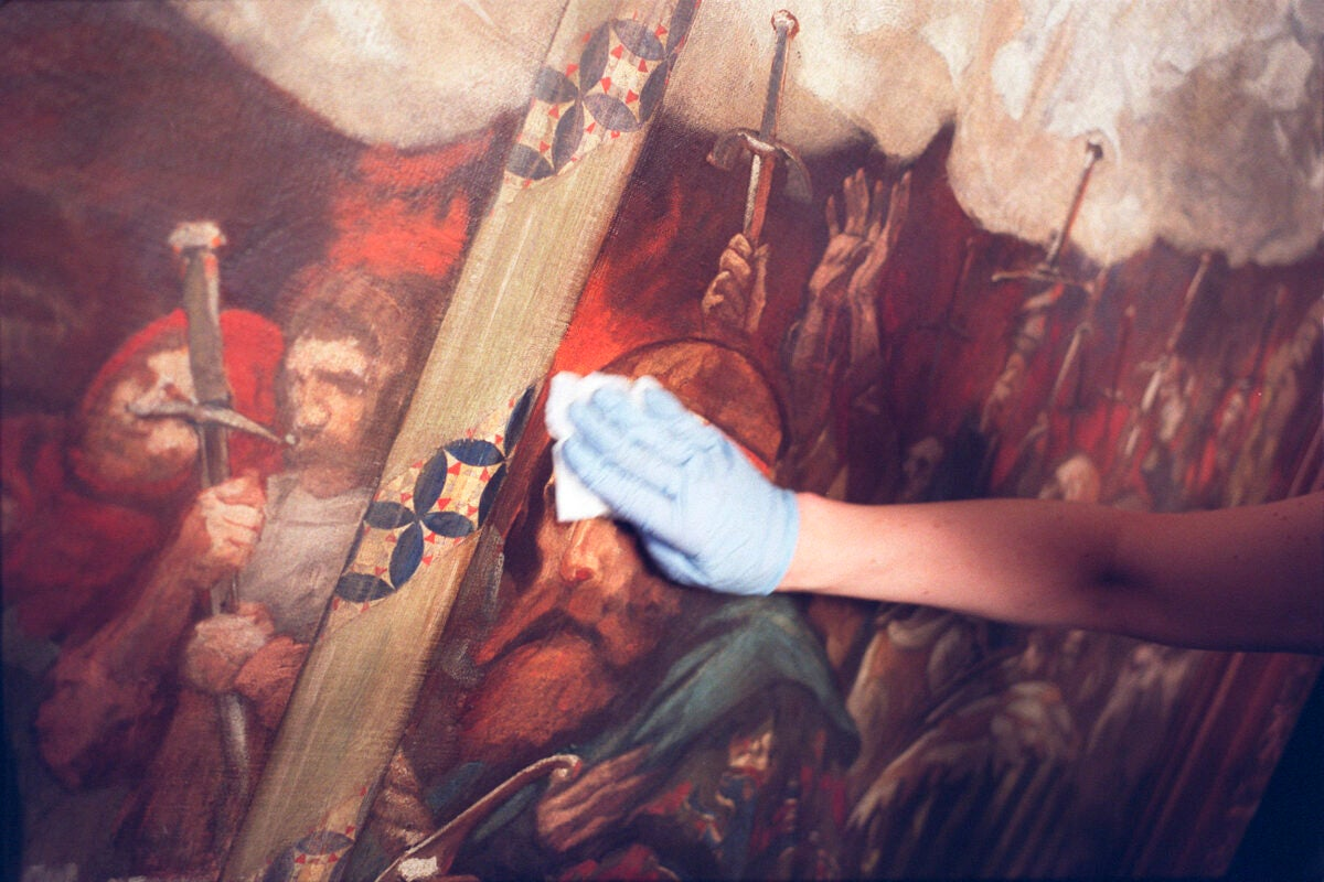 Restoring a painting.