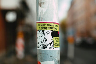 Pole with sticker.