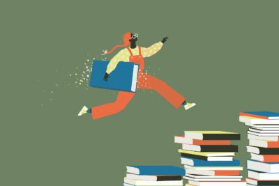 Young person leaping across stacks of books.