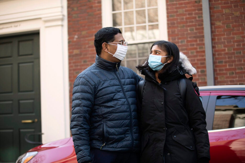 Two people in masks.