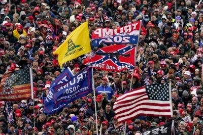 Jan. 6, 2021, file photo, supporters listen as President Donald Trump speaks.