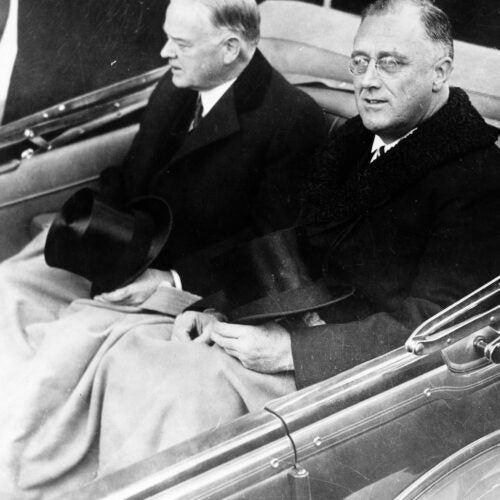 Franklin Delano Roosevelt and Herbert Hoover in convertible automobile on way to U.S. Capitol for Roosevelt's inauguration, March 4, 1933