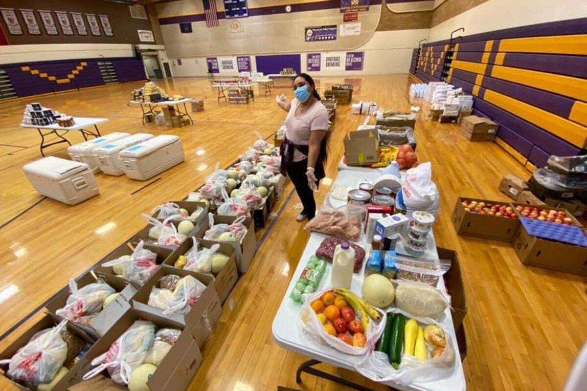 Shandiin Herrera assembles food boxes.