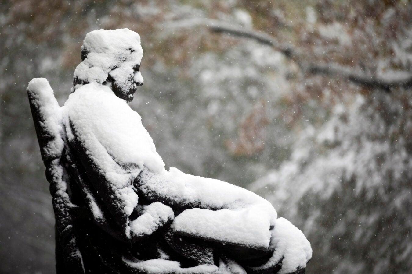 John Harvard in snow.