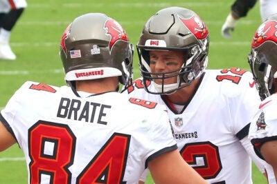 Cameron Brate and Tom Brady.