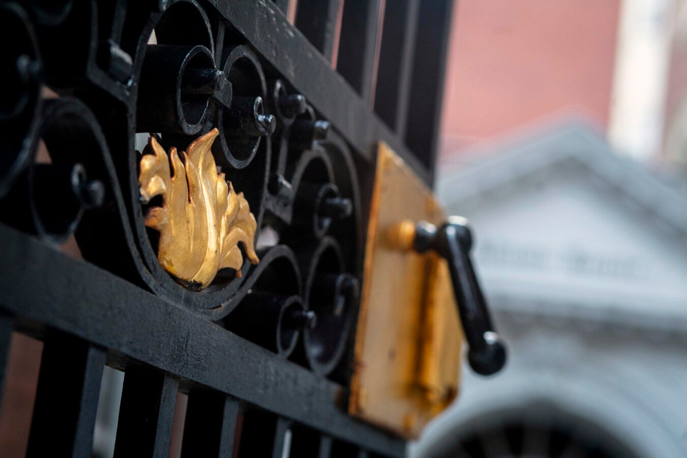 Golden gate clasp Is pictured up close on the entrance of Adams.