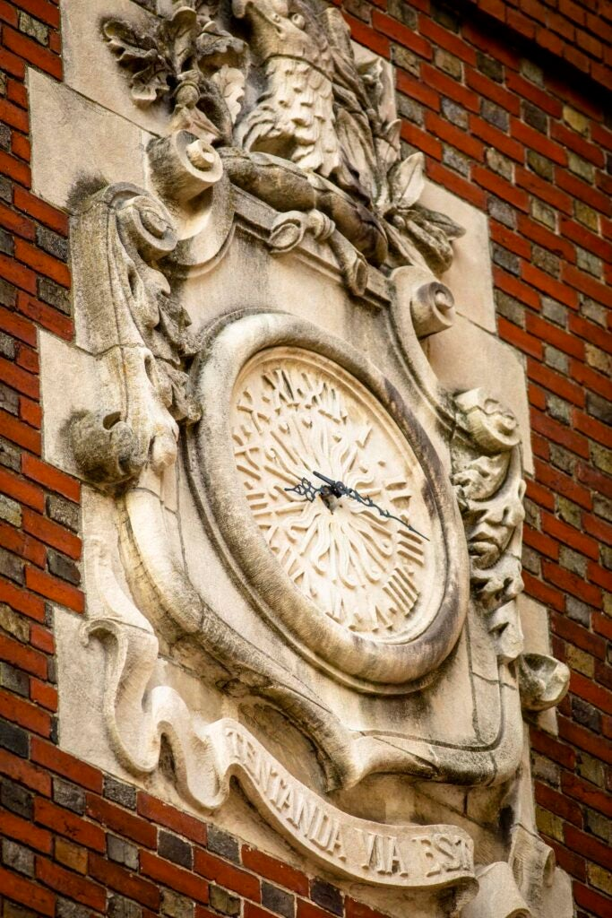 An elaborate clock is pictured on Adams House.