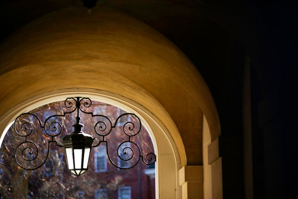 An elaborate lamp is pictured in the archway of Eliot House.