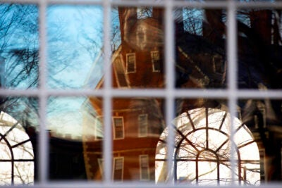 Kirkland House is reflected in the windows of Winthrop House.