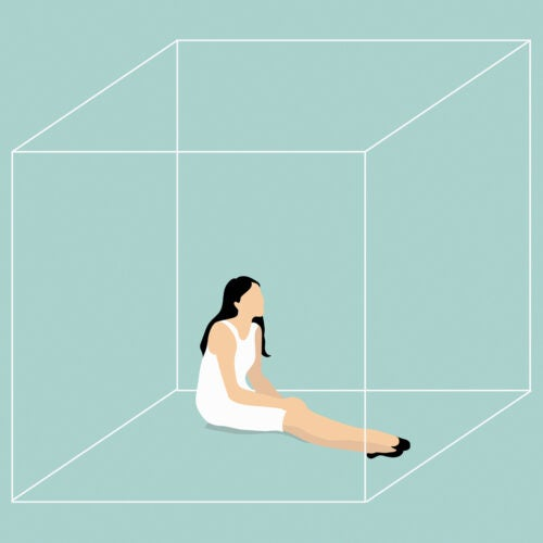 Young woman trapped in box.