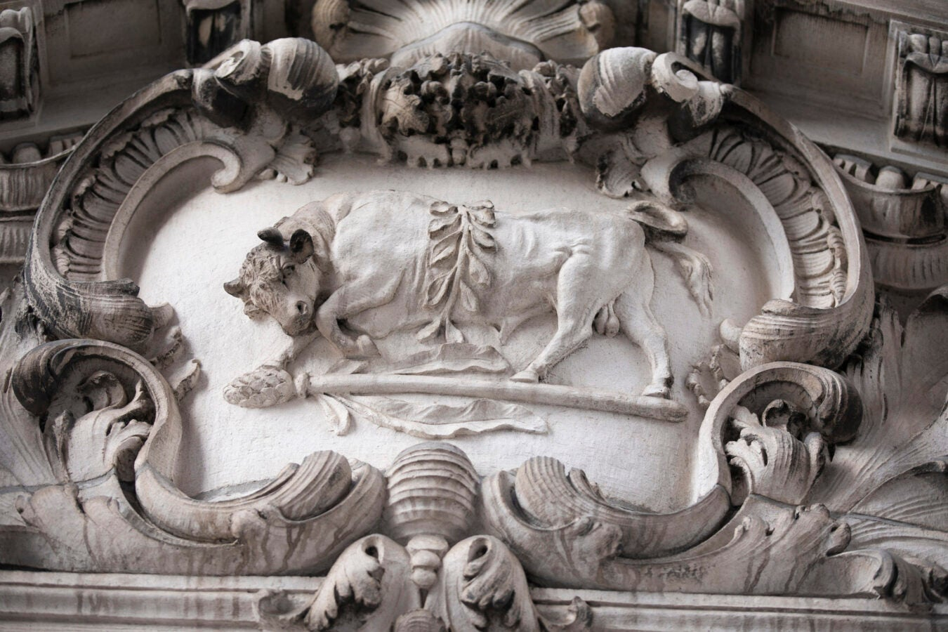 A bull is carved in marble.