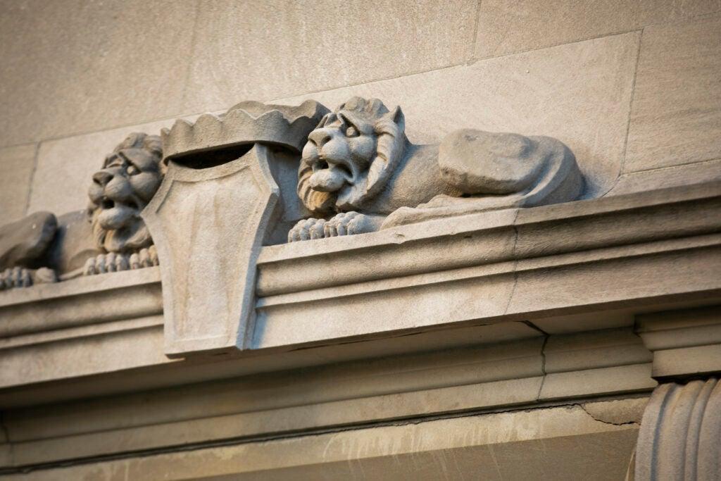 A pair of concerned lions adorns Adolphus Busch Hall.