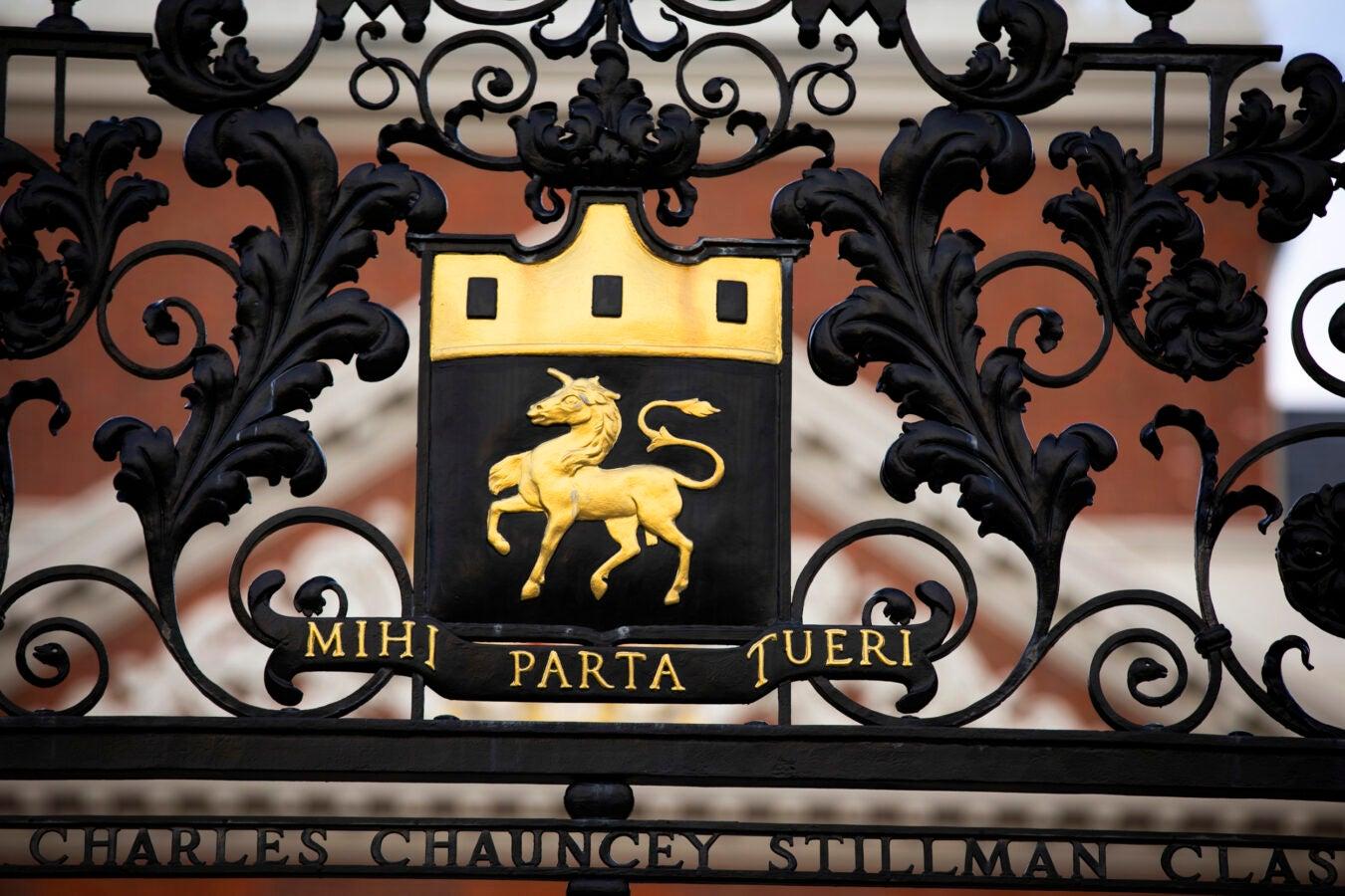 A golden unicorn bedecks the Dunster House gate.
