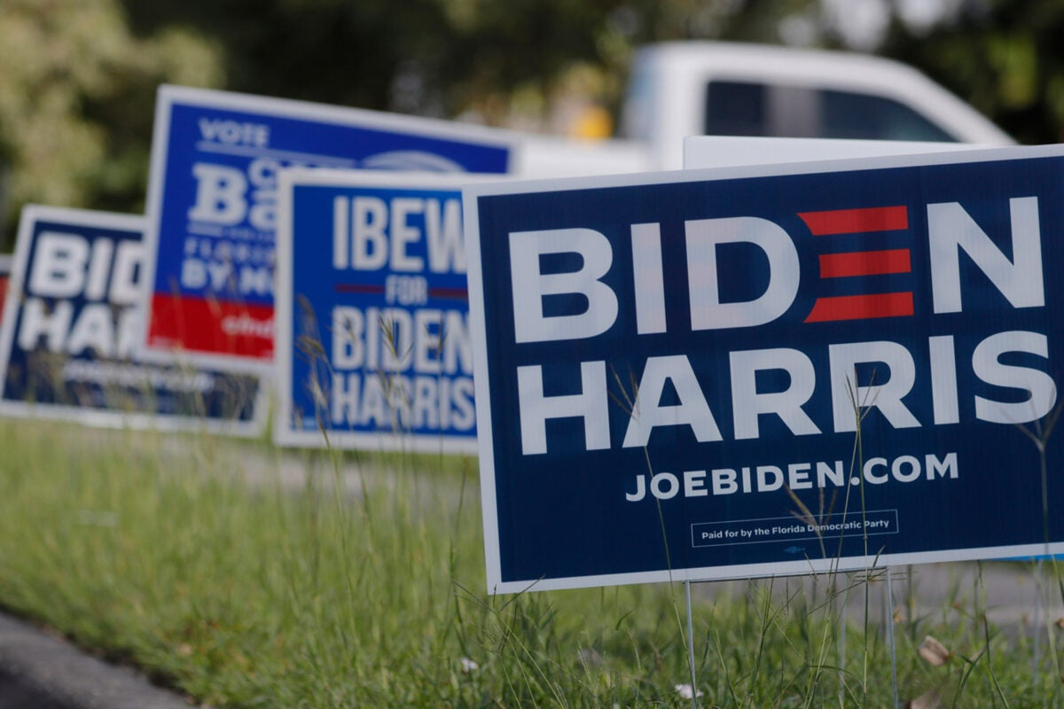 Political signs lining a street.