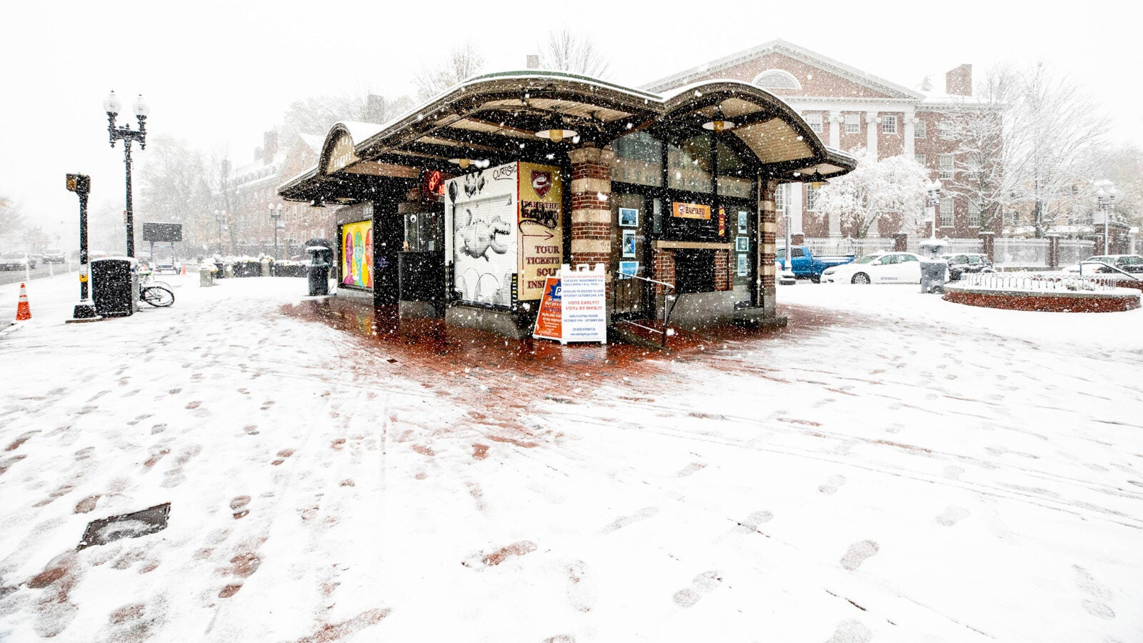 The Former Out of Town News Stand is covered in snow.