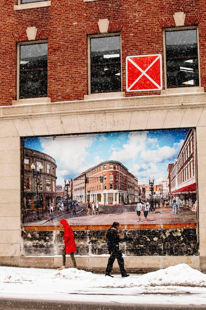 Bundled up pedestrians walk past an artist's rendering of the Abbot building in Harvard Square.