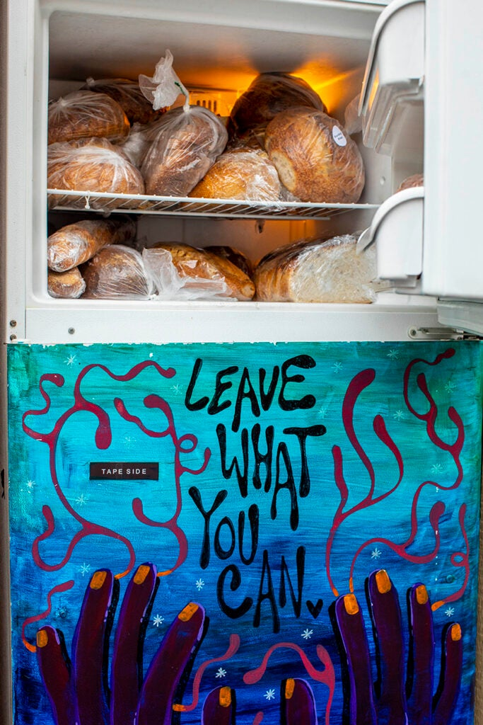 A refrigerator is filled with food as part of a mutual aid organization in Harvard Square.