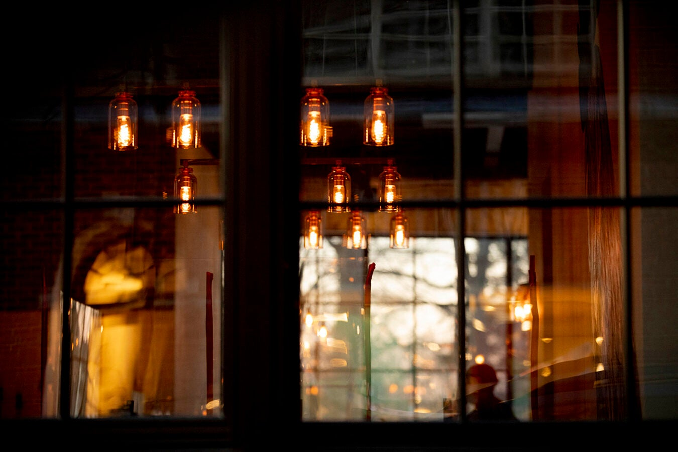 A patron watches tv inside Source a new restaurant on Church Street in Harvard Square.