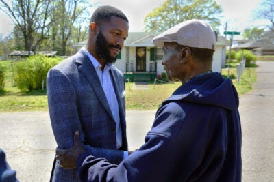 Mayor Woodfin and a citizen.
