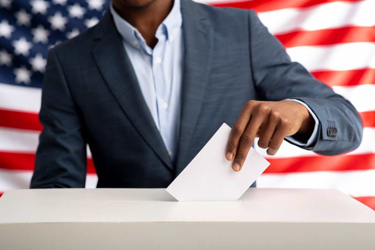 Black man voting.