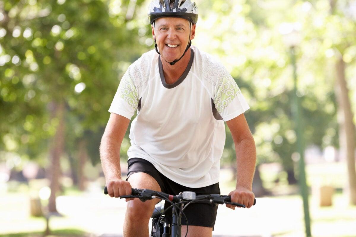Older man riding a bike.