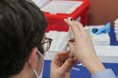 Pharmacist prepares vaccine.