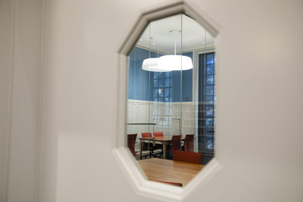 A window looks on to a smaller reading room.