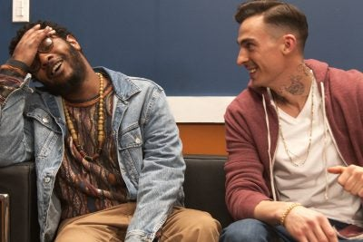Kadahj Bennett (left) plays Verb, a Black hype man for white rapper Pinnacle, portrayed by Michael Knowlton.