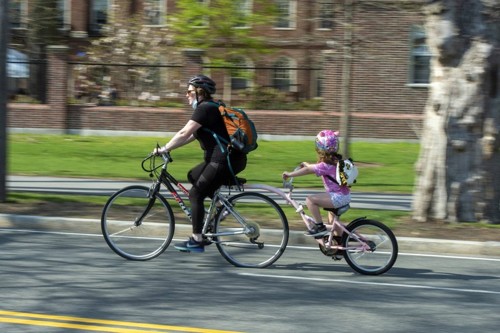 A mother and daughter cruise along the newly closed roadway on Memorial Drive.