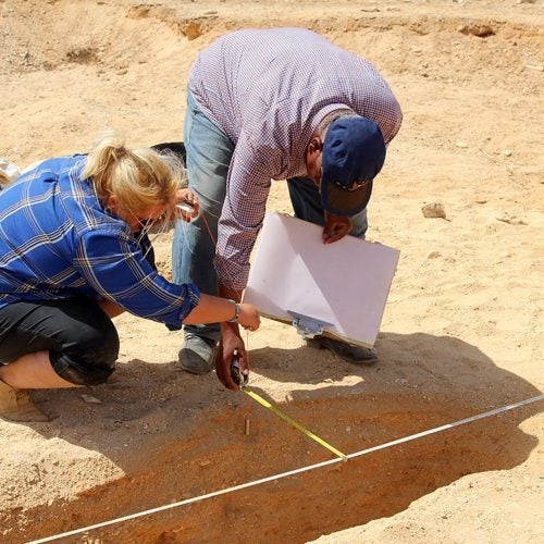Two people at an archaeology site.