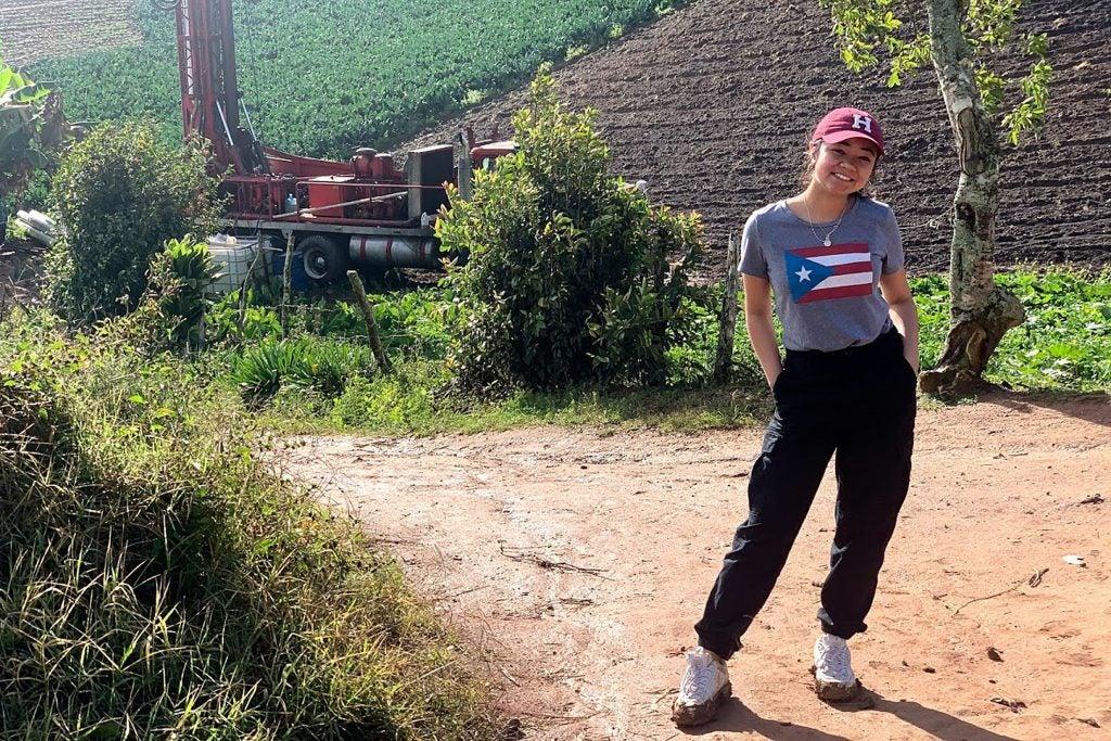 Daniela Villafuerte stands near drilling equipment.