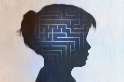 Illustration with a maze representing a child's brain.