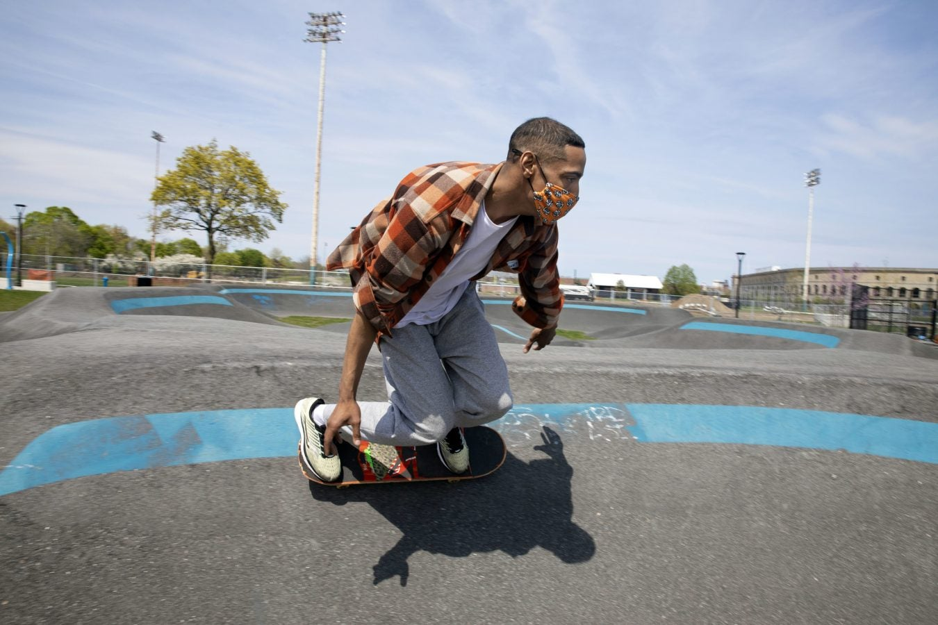 At the Smith Field in Allston, Will Newson, takes a relaxing ride around the pump track at the public skatepark.