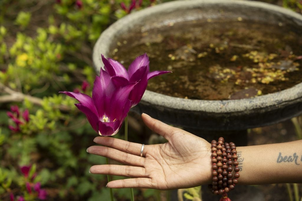 Jessica Chang practices yoga showing a flower blossom.