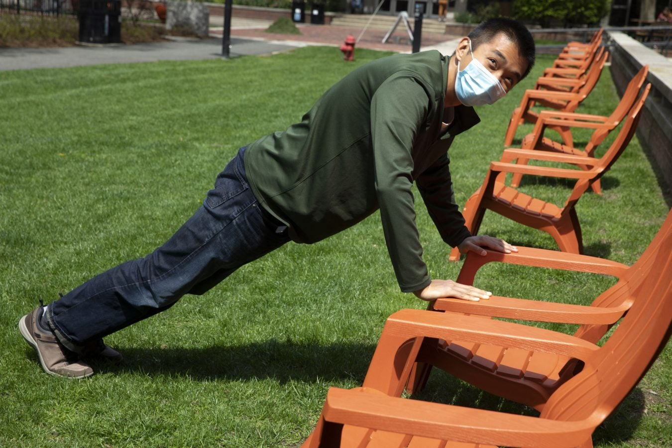 Mike Xie '22, Quincy House resident takes a break for a few push ups at Quincy House.