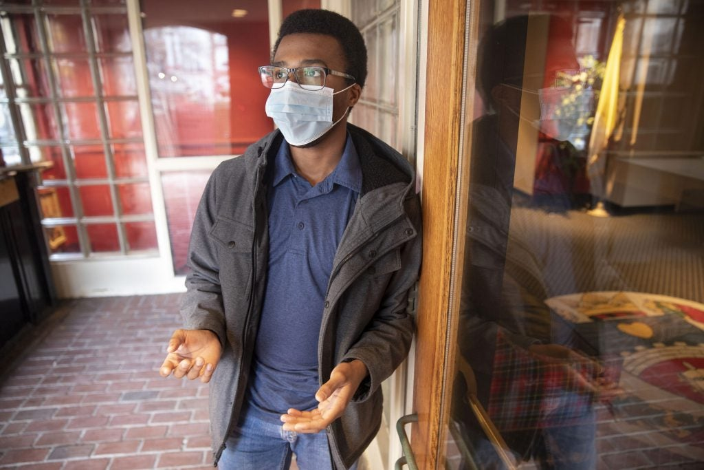Tresor Shimiye is seen at The Harvard Catholic Student Center where he practices his Christian faith.